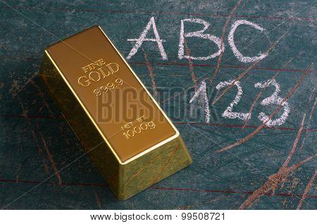 Value Of Education Concept Gold Ingot On Old Schoolboard