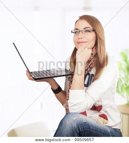 Student girl working at home, preparing to exam for university, dreamy woman sit at the laptop, gladly receives knowledge on the Internet