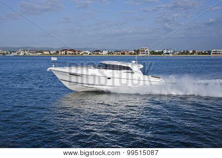 White Yacht Sailing Across A Coast