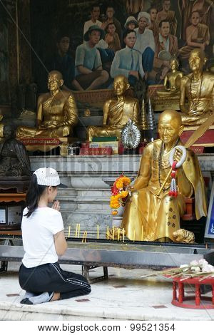 Chiangmai, Thailand - 5 July 2015 : Unidentified Female Tourism Pray To Monk Sculpture At Doi Suthep