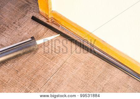 Application Of Caulking Gun