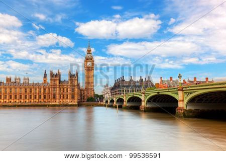Big Ben, Westminster Bridge on River Thames in London, England, UK. English symbol. Sunny day with puffy clouds