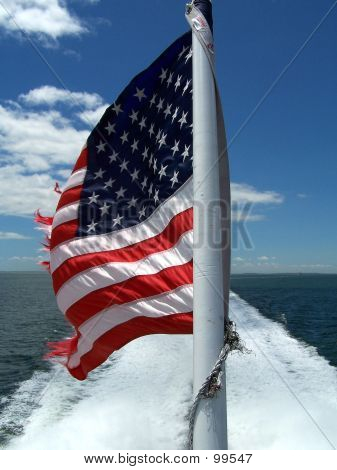 American Flag On The Back Of A Ship