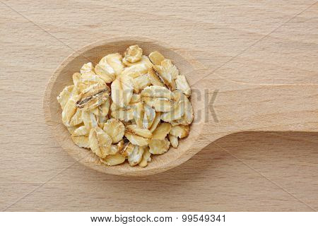 Wooden Spoon Filled With Rolled Oats
