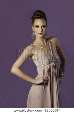 Portrait of regal brunette in purple