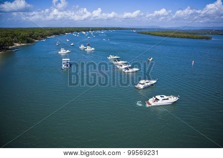 A Group Of Yachts Lined Up In The Sea