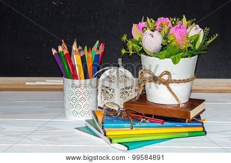 Teacher  Day. Flowers And Gift; Copybooks On The Teacher's Desk.