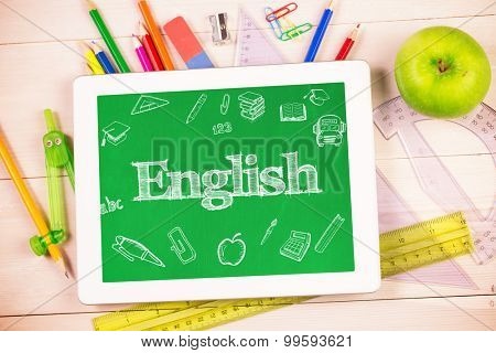 The word english and education doodles against students desk with tablet pc