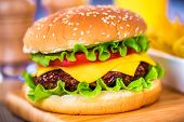 Tasty and appetizing hamburger cheeseburger poster