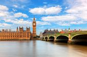 Big Ben, Westminster Bridge on River Thames in London, England, UK. English symbol. Sunny day with puffy clouds poster