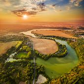 Beautiful sunset over Czech Valley Reservoir in The Litice suburban district of Pilsen.  Aerial view to scenic landscape in Czech Republic, Central Europe. HDR (warm filtered) photography.  poster
