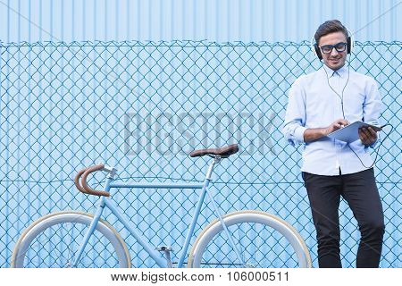 Businessman Listening To Music