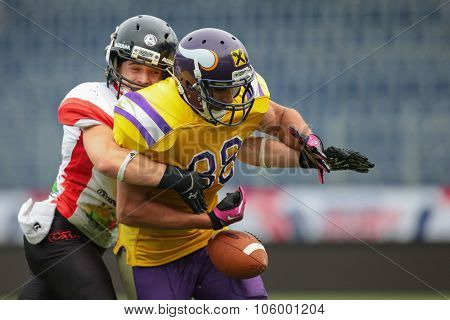 ST. POELTEN, AUSTRIA - JULY 26, 2014: DB Nikolaus Rabitsch  (#17 Lions) strips the ball from WR Sam Hassanein (#88 Vikings) during Silver Bowl XVII.