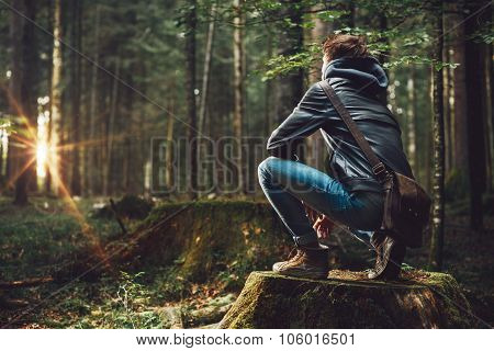 Young Man Exploring The Forest