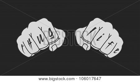 Arms with Thug Life tattoo. Chalk on blackboard