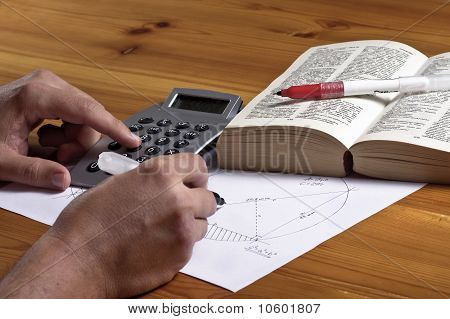 Man is writing geometry homework