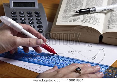 Woman drawing geometry homework