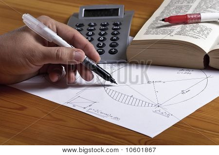 Left handed man with geometry paper