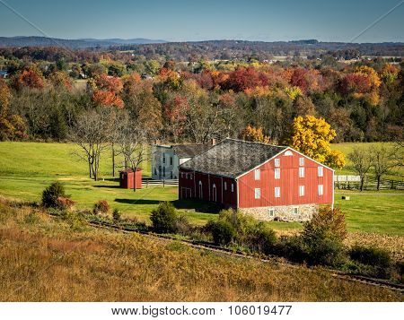Red Barn and Farm in Autumn Setting