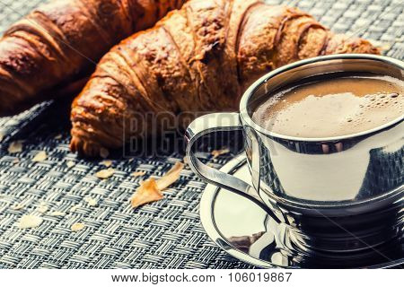 Cup of coffee. Stainless steel cup of coffee and two croissants. Coffee break business break