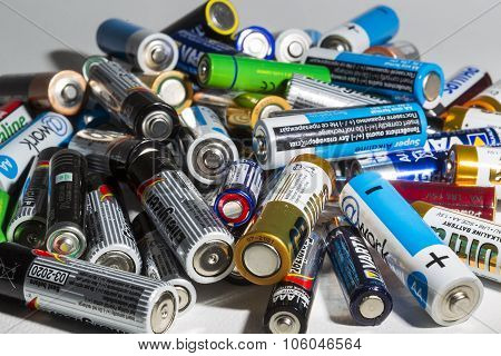 Different Types Of Used Batteries Ready For Recycling Lying In A Heap At A Recycling Center In Thess