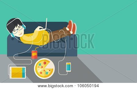 An asian man in glasses and headphones lying on a sofa with electronic devices and fast food vector flat design illustration. Horizontal layout with a text space.