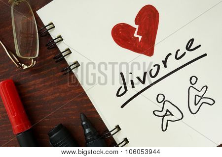 Notepad with divorce concept.