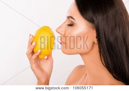 Sexy Beautiful Young Standing In Profil Woman Sniffing The Scent Of Lemon