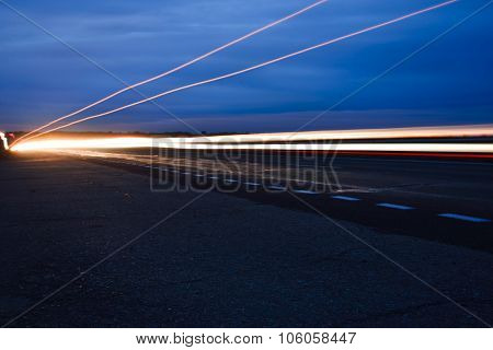 Streaks Of Light From Car Headlights On The Road