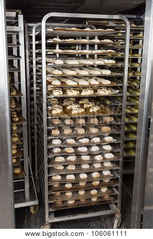 Bakery Rack With Fresh Bread Dough In Refrigerator
