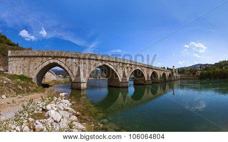 Old Bridge on Drina river in Visegrad - Bosnia and Herzegovina - architecture travel background
