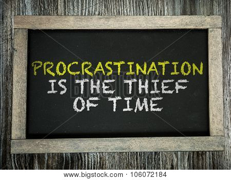 Procrastination is the Thief of Time written on chalkboard