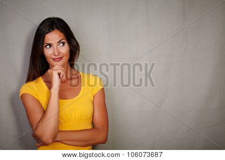 Pensive Woman Thinking With Hand On Chin Gesture