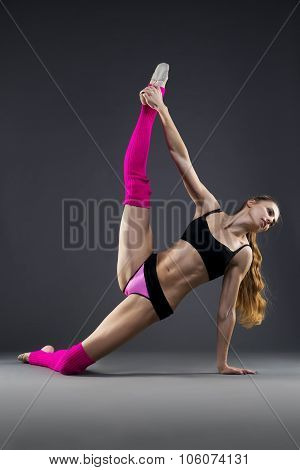 Beautiful Muscular Woman Doing Stretching Exercises