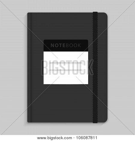 Moleskin notebook with black elastic band image.