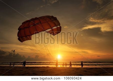 Man Is Preparing Para Sailing At The Beach In Thailand