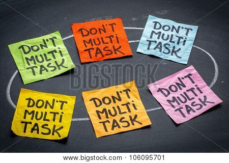 do not multitask sticky note abstract against blackboard - efficiency and productivity advice or reminder