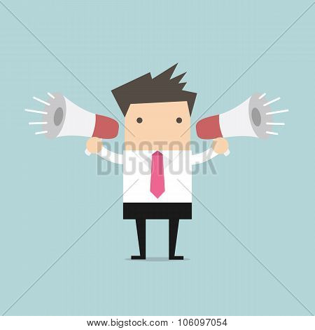 Businessman use two loudspeaker. marketing and advertise concept