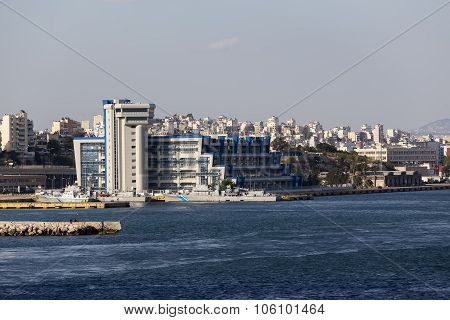 Pireas Greece- May 12 2015: Ferry boats cruise ships docking at the port of Piraeus Greece. The port of Piraeus is the largest passenger port in Europe and the third largest in the world.