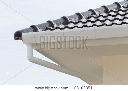 white gutter on the roof top of house poster