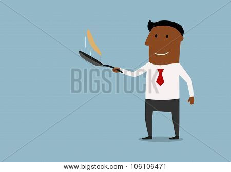 Happy businessman tossing up pancake