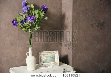 Design Vintage Interior With Flowers In The Bottle And The Image In The Frame