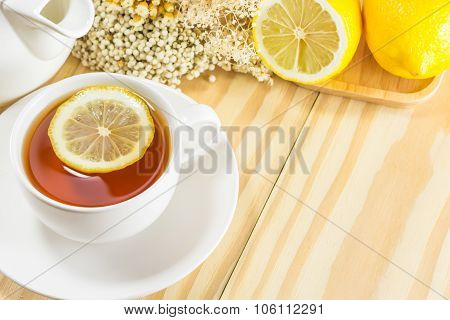 tea with lemon on wood backgroundwarm toning selective focus poster