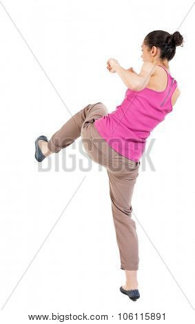 skinny woman funny fights waving his arms and legs. Rear view people collection.  backside view of person.  Isolated over white background. African-American kneaded lifting his feet.