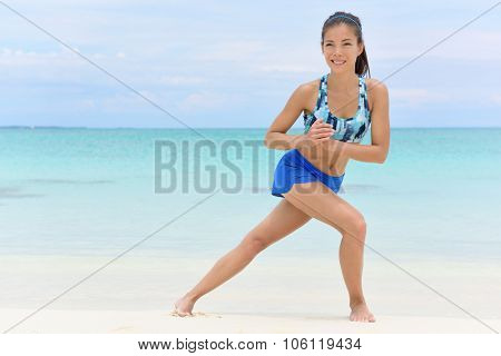 Fitness woman doing side lunges exercises to do leg strength training. Asian athlete working out her leg muscles to tone butt and glutes with bodyweight core workout.