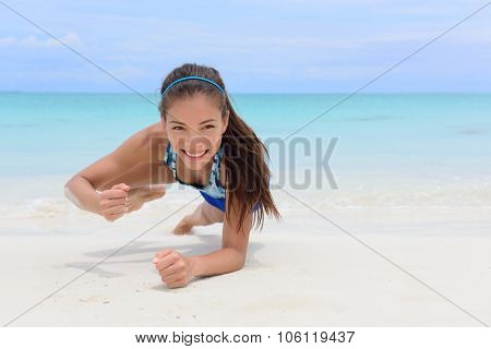 Core body workout - fitness woman planking doing forearm one arm spiderman knee to elbow crunch plank. Young Asian Chinese adult girl on beach strength training as part of a healthy lifestyle. poster