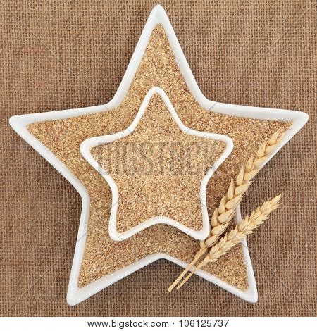 Wheat Germ in star shaped white porcelain dishes with wheat sheath forming an abstract background.
