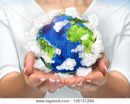 Our Planet In Our Hands. Open Hands Holding 3D Planet Earth With Clouds. Concept Of Saving Enviromen