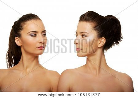 Two attractive topless sisters with make up. poster