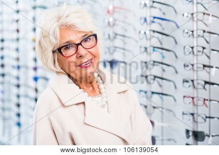 Elder Woman Trying On Glasses